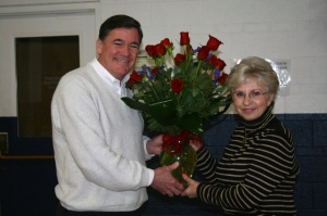 President Steve Rupp presents Past President Pam Fichter with red roses as a token of MRL's appreciation.